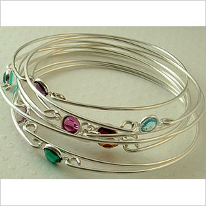 silver bangle with birthstone crystals