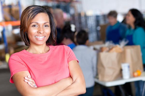 Happy woman volunteering at food bank