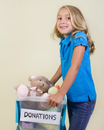 Girl donating toys