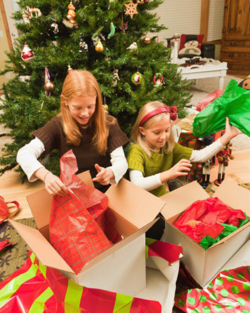 kids ripping open christmas presents