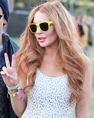 Lindsay Lohan wearing colored rimmed sunglasses