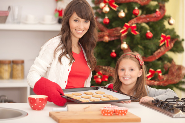Mom and daughter making Christmas cookies