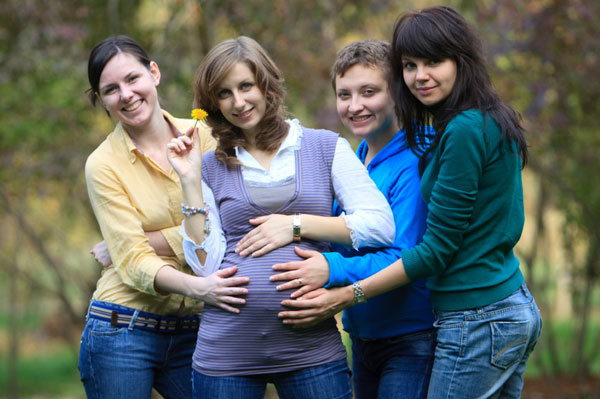 Pregnant woman with her pals