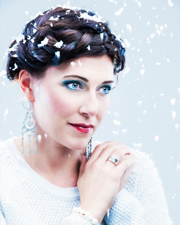 Woman in winter snow wearing makeup