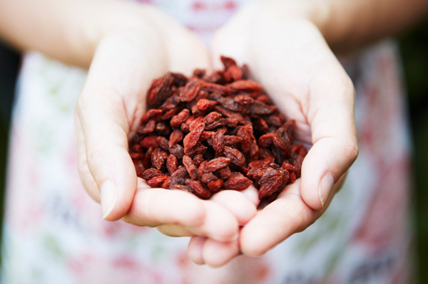 Woman holding goji berries