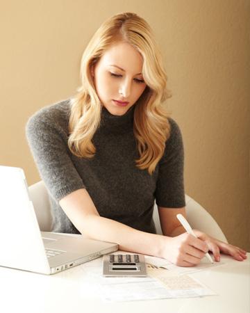 Woman paying bills at home