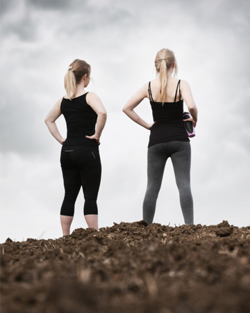 Fit women in mud