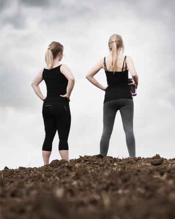 Fit women in mud