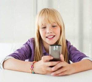 Tween girl on cell phone