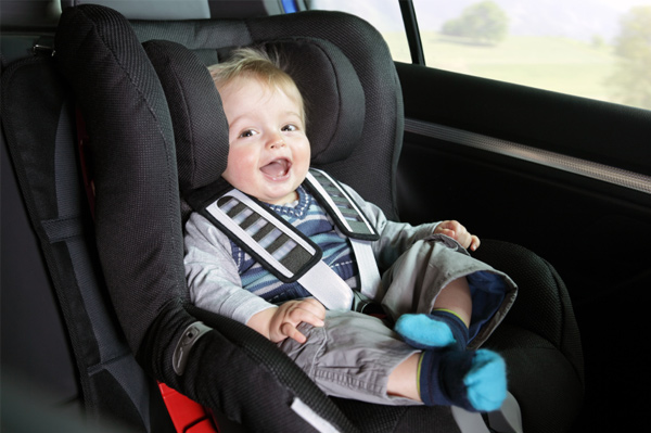 Happy baby in car seat