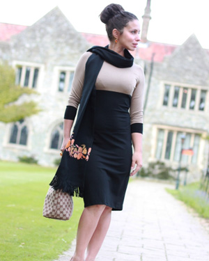 Black and camel colored maternity dress with scarf accent