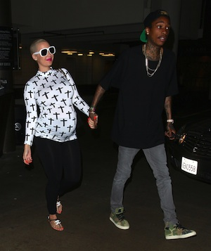 Amber Rose pregnant walks with Wiz Khalifa.