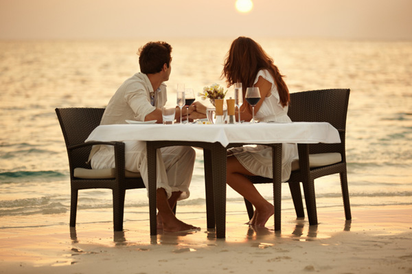 Couple having dinner on beach