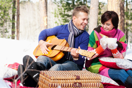 Couple having winter picnic