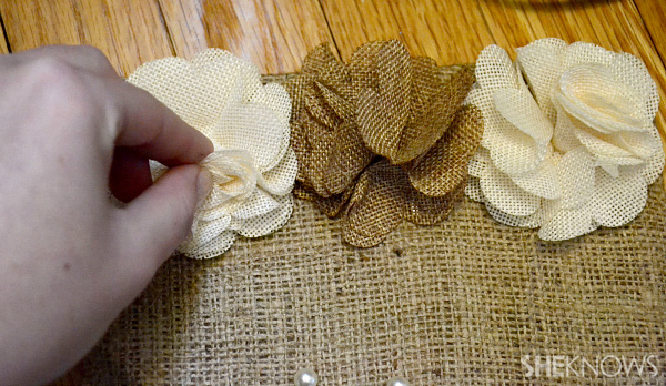 Glue decorative accessories to the burlap