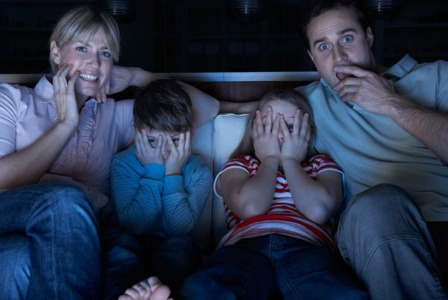 Family watching a scary movie