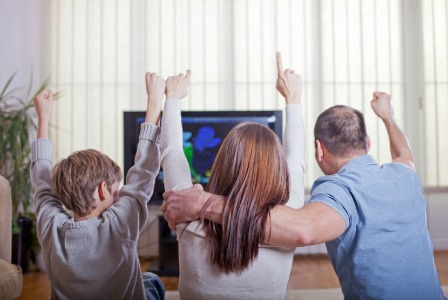 Family watching the Super Bowl | Sheknows.com