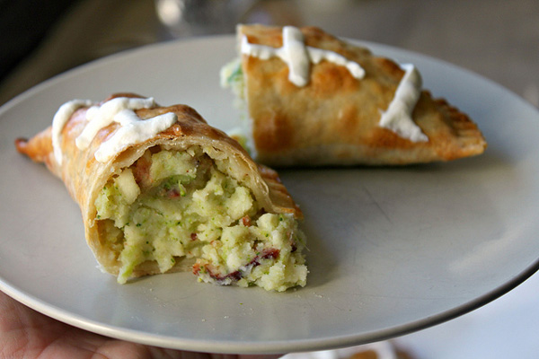 Football empanadas stuffed with mashed potatoes, broccoli, crispy bacon and cheese