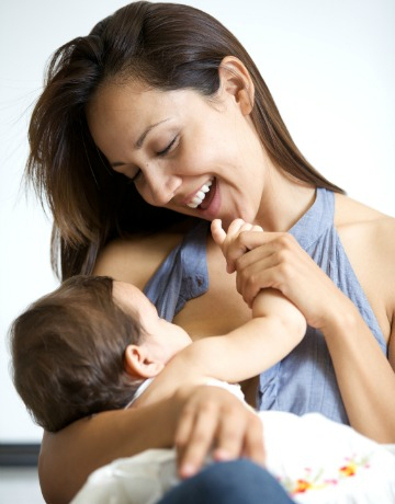 Happy mom breastfeeding