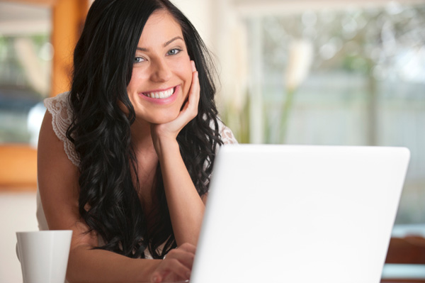 Happy woman on computer