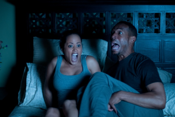 Marlon Wayans and Essence Atkins in A Haunted House