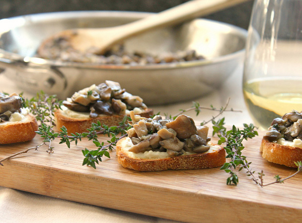 Mushroom bruschetta on crunchy cheese toasts