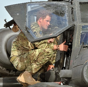 Prince Harry loading into an Apache