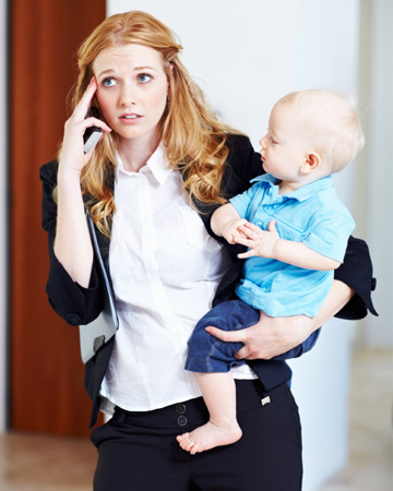 Stressed career woman holding baby