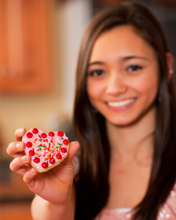 Teen baking cookies for Valentine's Day