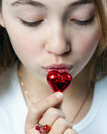 Tween kissing Valentine's Day chocolate