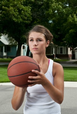 Teen playing basketball