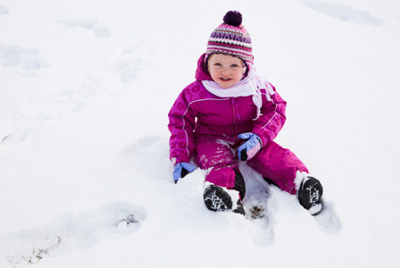 Toddler girl in snow
