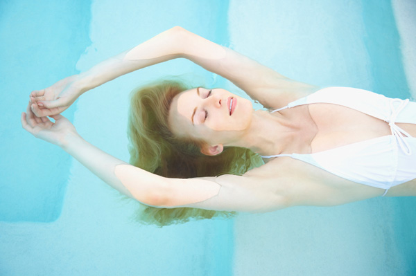 Woman floating in spa