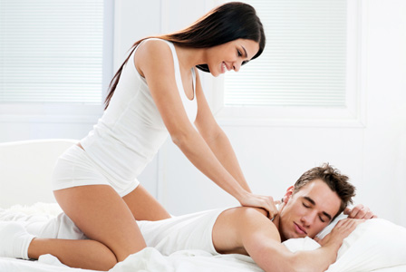 Woman giving boyfriend a massage