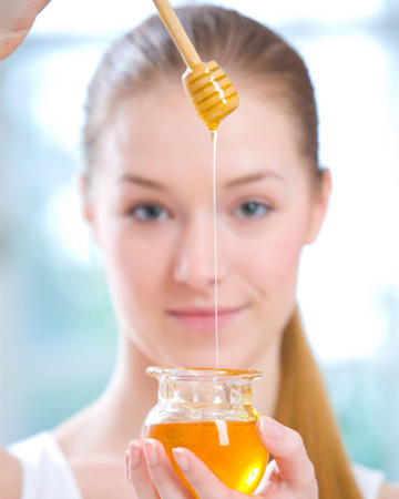 Woman holding jar of honey