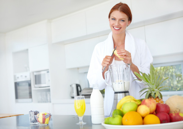 Woman holding out protein shake