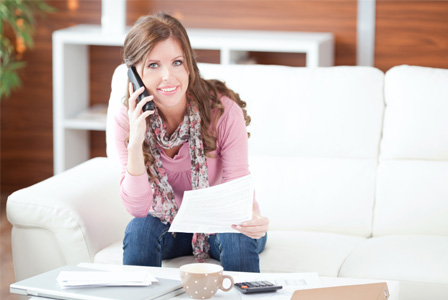 Woman negotiating bills on phone