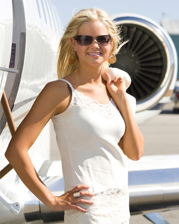 Woman outside of private jet
