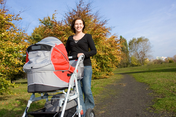 Happy mom pushing stroller