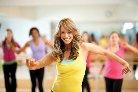 Smiling woman fitness dancing