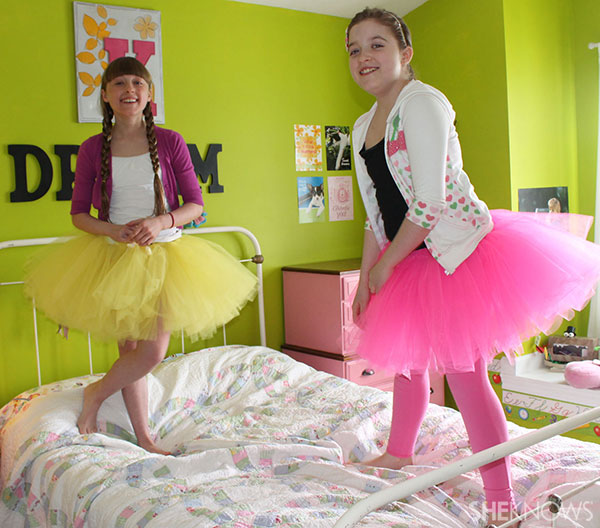 girls jumping on bed in homemade tutus