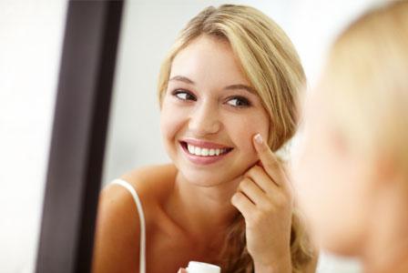 Girl applying face cream