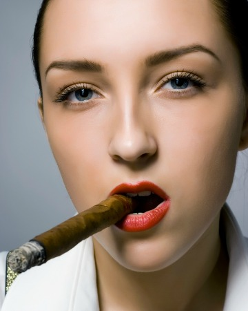 Woman smoking cigar