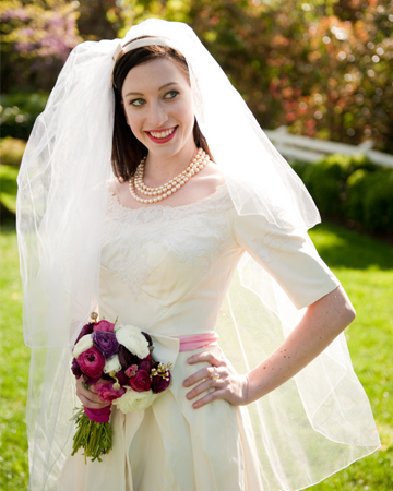 Bride wearing dress with sleeves