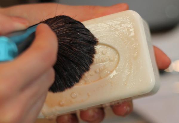 Cleaning makeup brush with soap