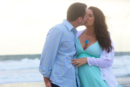 Couple on babymoon at beach
