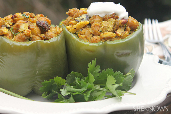 Curried chickpea stuffed peppers with slivered almonds and yogurt