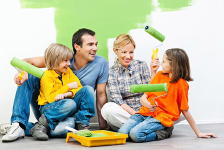 family painting a room