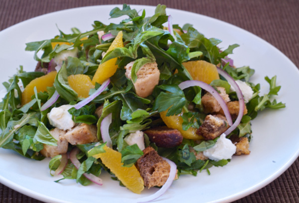 Goat cheese panzanella with chicken, tangerines and tomato vinaigrette