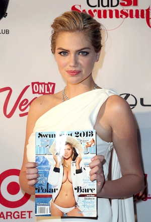 Kate Upton holds up her 2013 SI Antarctic cover